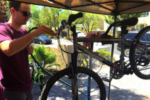 One of our team members hard at work repairing a bicycle that will be donated.